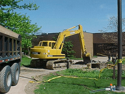 back hoe working commercial excavation near Cleveland by Sitework Developing