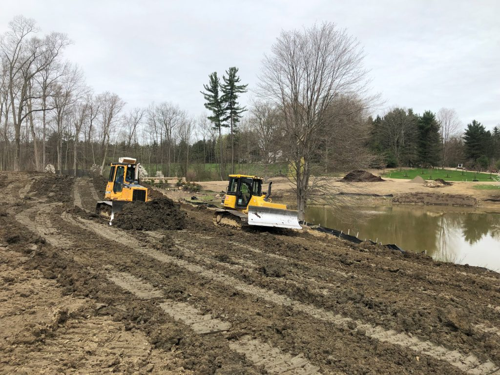 Sitework Developing crew performs yard grading near Cleveland at Chardon Ohio property